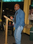 Le Hinton reading at Almost Uptown photo by g emil reutter