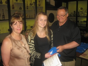 Sarah Smolnickiof Saint Hubert High School receives her gift card, certificate and a Ryerss shirt from Diane Sahms-Guarnieri and Gary Martinez of The Friends of Ryerss