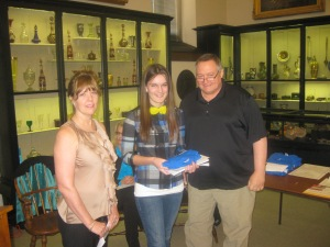 Jessica Bachman receives her certificate and shirt from Diane Sahms-Guarnieri and Gary Martinez
