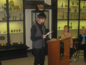 10th Grade Third Prize winnerHarry Yang of Central High School reads his poem Time After Time
