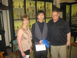 Harry Yang receives his certificate and Ryerss shirt from Diane Sahms-Guarnieri and Gary Martinez