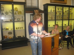 11th Grade First Prize wiinerr Drew Schmidt of  Abington Sr. High School reads his poemDrifting Through  Frozen Memories