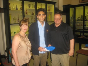 Dominick Palma receives his certificate and Ryerss Shirt from Diane Sahms-Guarnieri and Gary Martinez