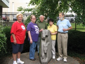 Artists gather around Three Bears Sculpture by George Pappshviz at Fox Chase Library
